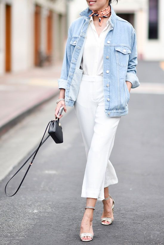 a white shirt, white cropped pants, a bleached denim jacket, silver shoes and a small black bag