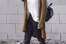 10 a white tee, black ripped skinnies, black sneakers, a brown cardigan and a black cap for the fall