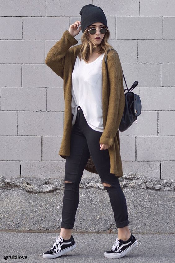 a white tee, black ripped skinnies, black sneakers, a brown cardigan and a black cap for the fall
