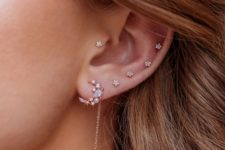 10 beautiful ear accessorizing with little floral studs including helix and tragus piercing