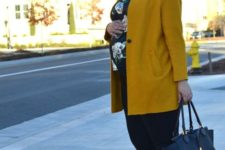 10 black jeans, a dark floral shirt, black flats, a bright mustard coat for a bold look this fall