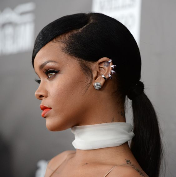 Rihanna wearing several ear piercings for a bold and statement look