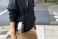 11 a black hoodie, a gold sequin midi skirt, white and black sneakers and a mathcing bag for a sport chic look