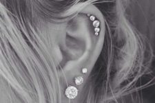11 a glam multiple helix piercing and three earrings in the lap for more shine