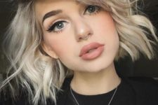 11 a neutral makeup and a tiny nose hoop piercing for a touch of rock in the look