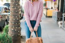 11 a pink sweater, blue jeans, a camel crocodile leather bag and camel heeled loafers