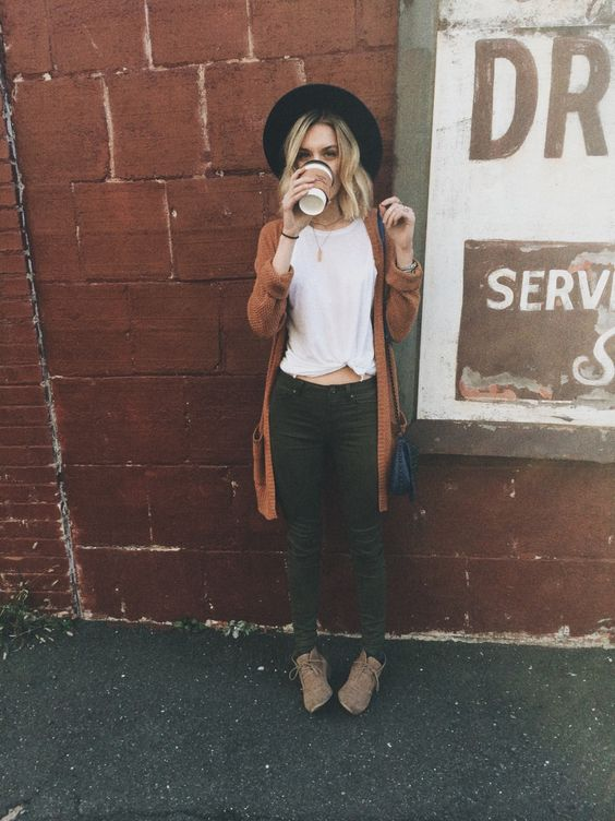 a white tee, green jeans, brown boots, a rust colored cardigan and a black hat for a cool fall inspired look