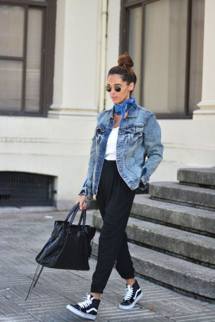 a white top, black high waisted pants, a blue denim jacket, black sneakers and a comfy tote