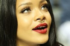 12 Rihanna wearing a gorgeous embellished nose hoop piercing and layered necklaces for a wild touch