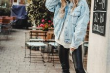 12 a whte sweater, black leather leggings, a bleached oversized denim jacket and black trainers