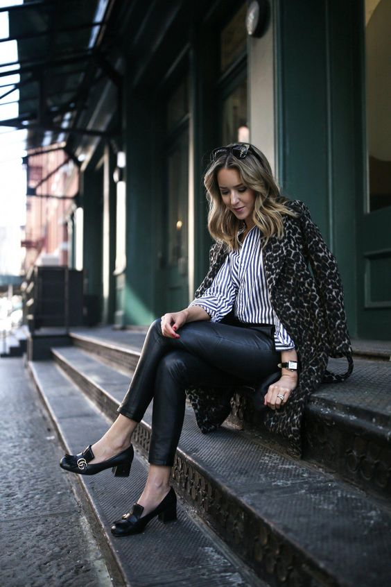 black leather leggings, a striped shirt, a leopard print coat and black heeled loafers