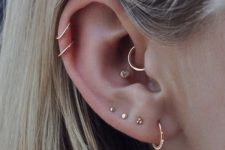 12 elegant multiple ear piercings with studs and hoops including the conch, helix and lap