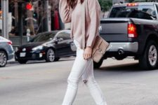 12 white ripped skinnies, a blush oversized sweater, snake print boots and a neutral bag