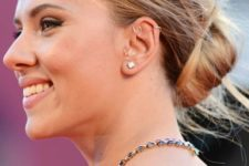 13 Scarlet Johansson wearing a double helix piercing with hoops and some more earrings