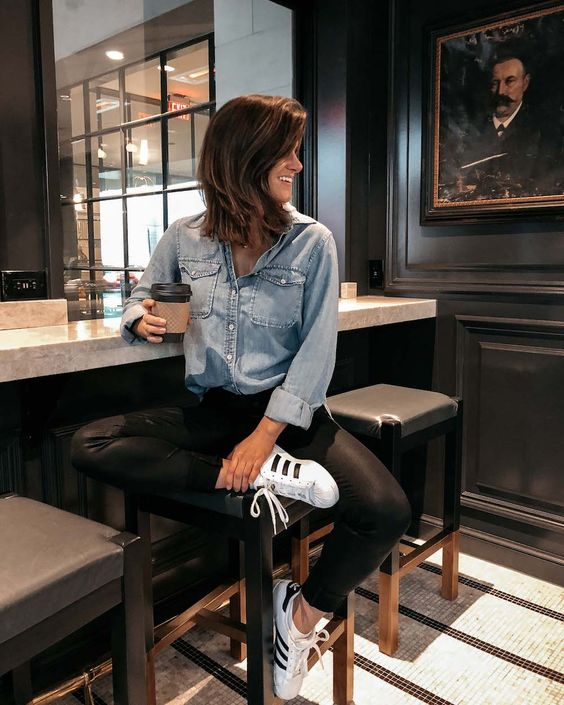 a bleached chambray shirt, black leather pants, white sneakers for a relaxed weekend look