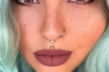 13 a gorgeous double nose hoop piercing and an additional spetum ring for a super rebellious look