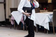 13 a white oversized shirt, black velvet pants, a black bag and red heeled loafers for an accent