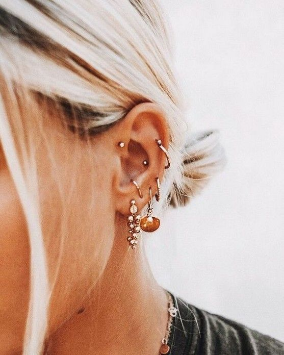 multiple ear piercings including helix, conch and helix - studs and hoops are perfectly matched