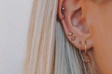 13 multiple piercings plus two helix piercings for a cool and super bold look