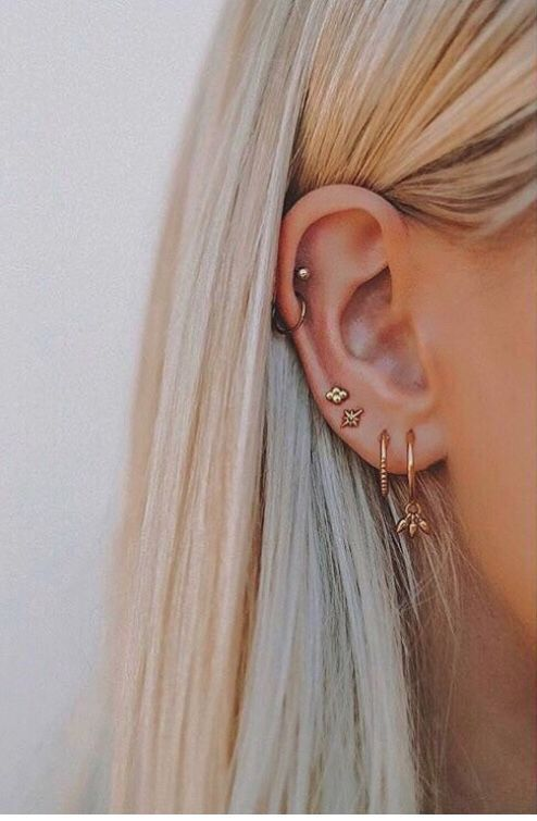 multiple piercings plus two helix piercings for a cool and super bold look