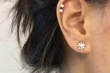 14 a floral earring and two piercings in the helix are a cool and fresh idea to try