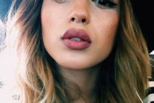 14 a tiny nose hoop piercing is a chic idea to add an accent to your face and it's veyr trendy