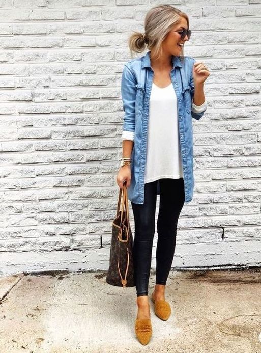 a white long top, a blue chambray shirt, black leggings, camel loafers and a comfortable bag