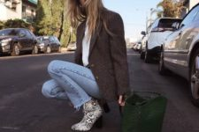 14 a white tee, blue raw hem jeans, a tweed jacket, snake print boots and a dark green bag