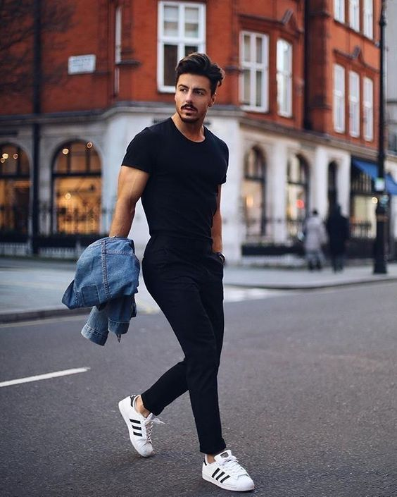 an elegant look with a black fitting tee, black pants, white sneakers and a blue denim jacket