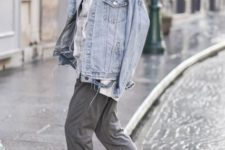 14 cuffed grey pants, a neutral shirt, a bleached denim jacket and grey trainers for a sport chic look