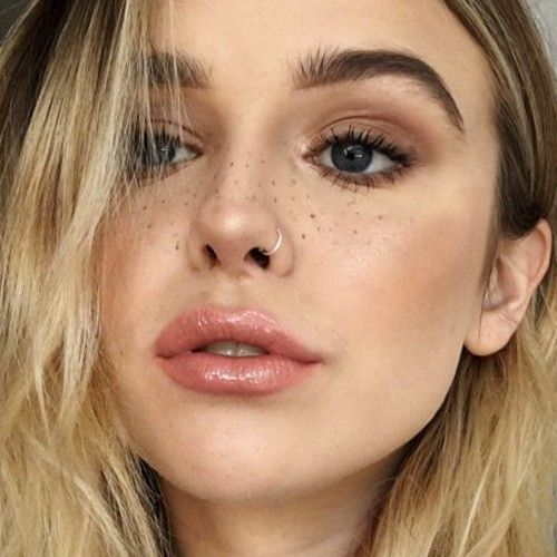 a casual and neutral nose ring piercing will add a daring touch even to the most neutral makeup