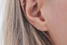 15 a minimalist look with hoops in the helix and mini studs in the lower part of the ear