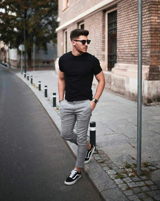 grey pants, a black fitting tee, black sneakers and no socks make up a comfy weekend look