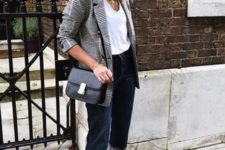 16 a business casual look with a white top, navy jeans, a plaid blazer, a black bag and red heeled loafers