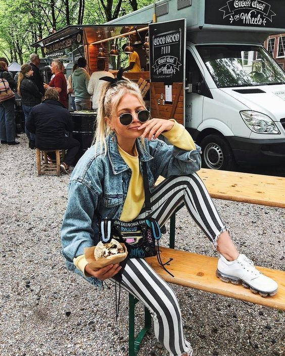 a yellow sweatshirt, high waisted striped pants, a blue denim jacket, white sneakers for a 90s inspired outfit