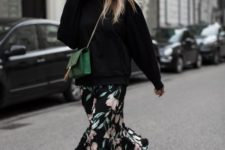 16 an oversized black hoodie, a dark floral midi skirt, metallic shoes and a green crossbody to make a statement