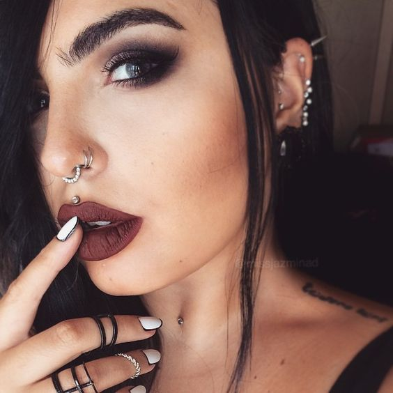 double nose hoop piercing plus an embellished hoop in the septum to finish off the super bold look