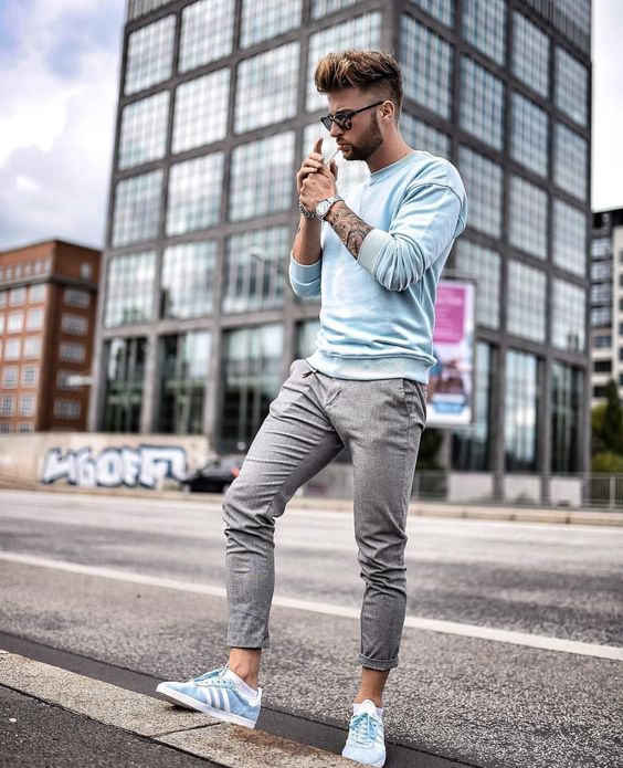 a nice summer to fall transitional look with grey pants, an aqua sweatshirt, blue sneakers make up a chic sporty look for weekends