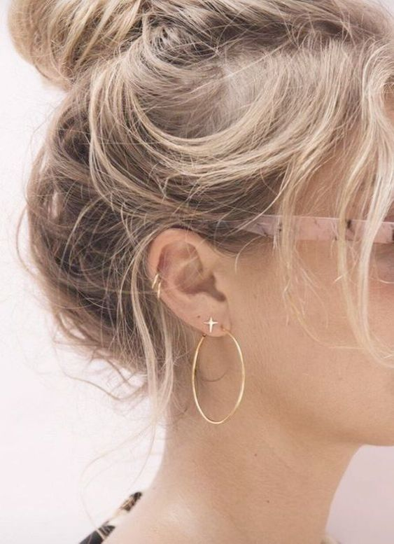 two earrings in the lap and two in the helix for a symmetrical yet non-boring look