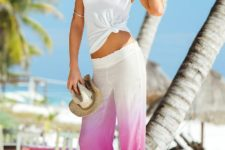 With beige hat, white top and flat sandals