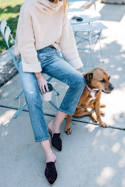 With beige loose sweater and cropped jeans