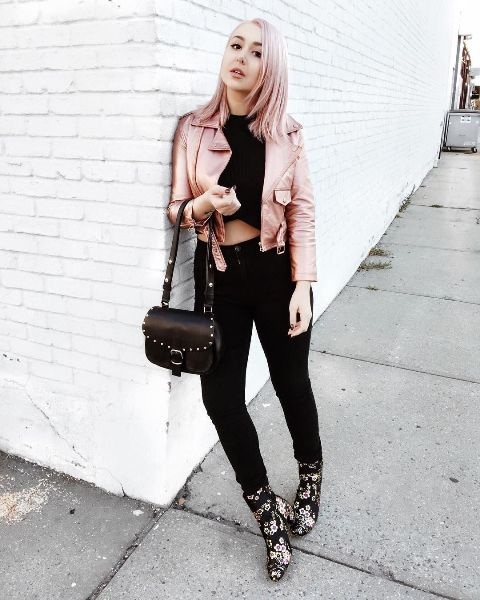 With black crop top, black pants, leather bag and metallic jacket