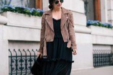 With black dress, black bag and brown jacket