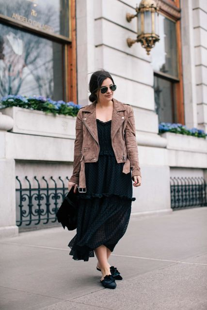 With black dress, black bag and brown jacket