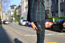 With black high heels and black small clutch