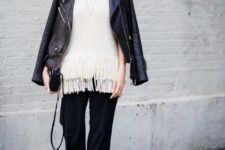 With black leather jacket, small bag, sneakers and black culottes