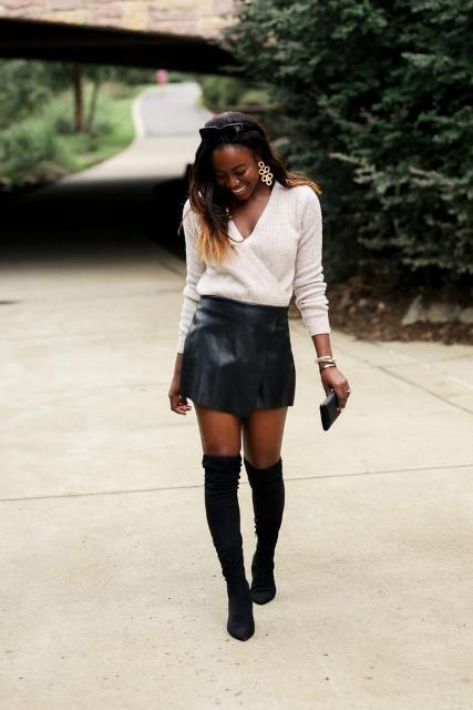 With black leather mini skirt, black high boots and clutch