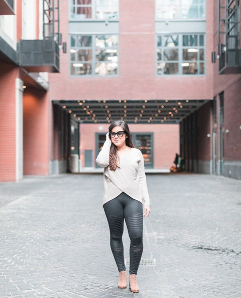 With black leggings and high heels