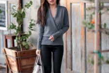With black leggings, white bag and black pumps
