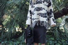 With black midi skirt, black big bag and ankle strap shoes